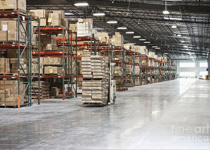 Architecture Greeting Card featuring the photograph Forklift Moving Product In A Warehouse by Jetta Productions, Inc