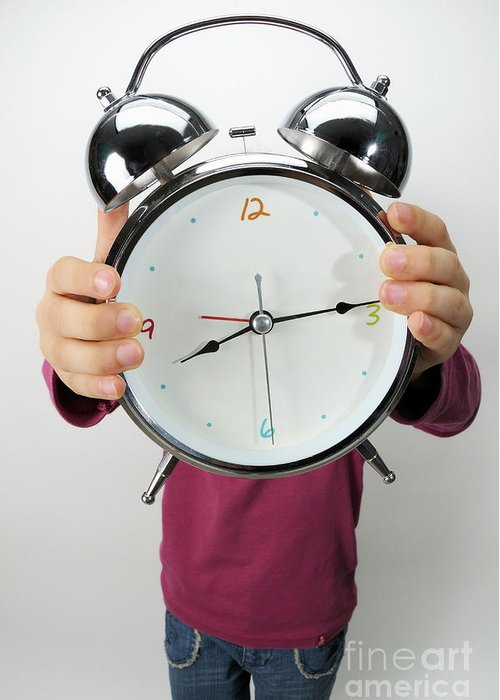 Design Greeting Card featuring the photograph Girl Holding Alarm Clock Over Face by Sami Sarkis