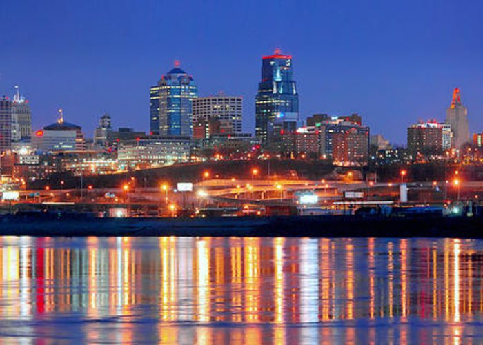 Kansas City Missouri Skyline At Night Greeting Card featuring the photograph Kansas City Missouri Skyline At Night by Jon Holiday