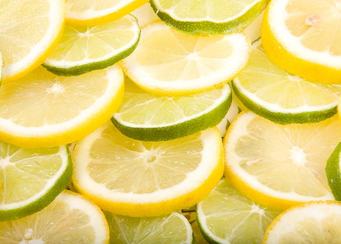Lemons; Citrus; Citrus Fruit; Citrus Fruits; Close Up; Cross Section; Culinary; Food; Fruit; Fruits; Green; Key Lime; Key Limes; Lime; Limes; Slice; Sliced; Slices; Group; Sour Greeting Card featuring the photograph Lemons And Limes by James BO Insogna