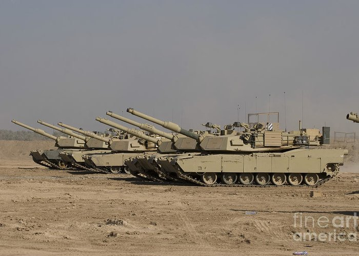Camp Warhorse Greeting Card featuring the photograph M1 Abrams Tanks At Camp Warhorse by Terry Moore