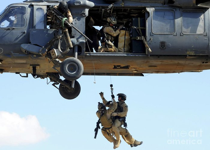 Csar Greeting Card featuring the photograph Pararescuemen Are Hoisted Into An Hh-60 by Stocktrek Images
