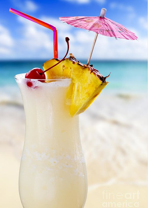 Pina Colada Greeting Card featuring the photograph Pina Colada Cocktail On The Beach by Elena Elisseeva