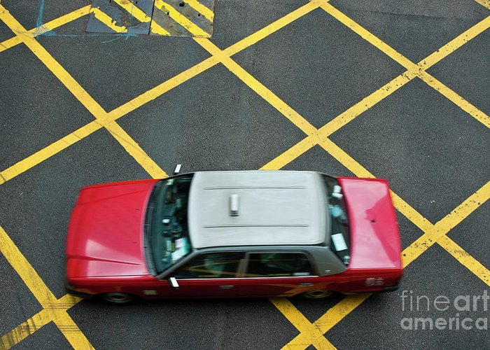 Asia Greeting Card featuring the photograph Red Taxi Cab Driving Over Yellow Lines In Hong Kong by Sami Sarkis