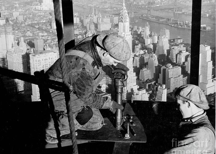 Riveters; Riveting; Male; Work; Labour; Workers; Working; Labourers; Construction; Building; History; Historical; Landmark; Skyscraper; High-rise; Empire State Building; 1930s; 30s; Thirties; Us; Usa; America; American; United States; High; Challenge; Risk; Danger; Courage; Bravery; Heights; Achievement; Scale; Teamwork; Chrysler Building; Aerial View; New York; Manhattan; Architecture; Urban; City; Cityscape; Dramatic; Builder; Builders; Scenic; Concentration; Black And White Photograph; B/w Photo; Photography Greeting Card featuring the photograph Riveters On The Empire State Building by LW Hine