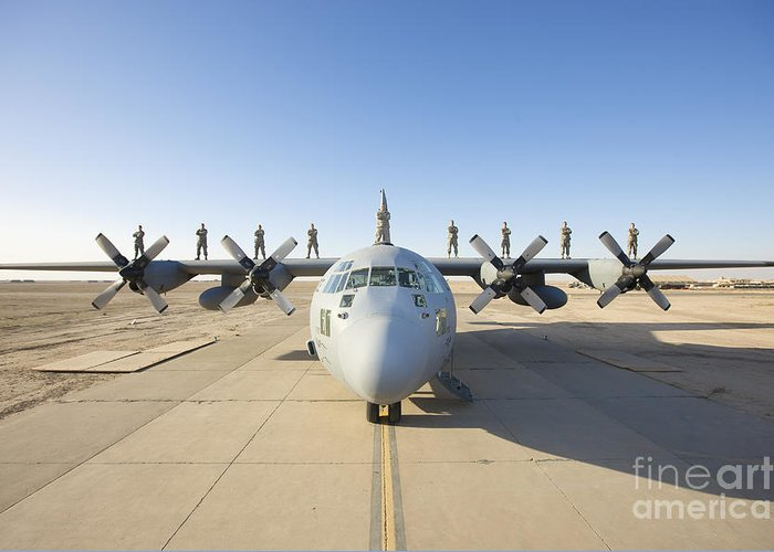Air Force Greeting Card featuring the photograph Troops Stand On The Wings Of A C-130 by Terry Moore