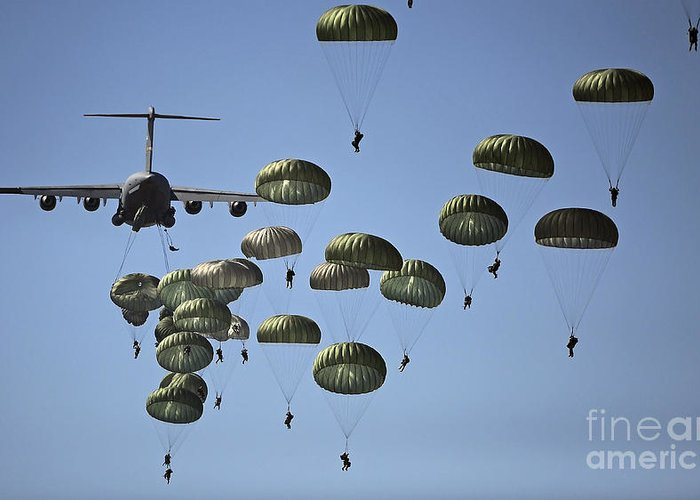 Parachutist Greeting Card featuring the photograph U.s. Army Paratroopers Jumping by Stocktrek Images