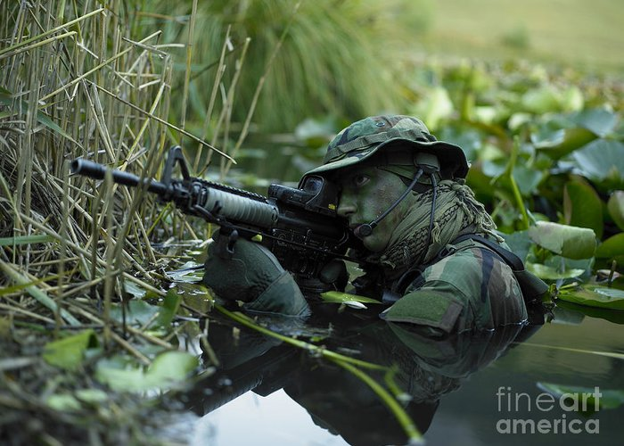 Special Operations Forces Greeting Card featuring the photograph U.s. Navy Seal Crosses Through A Stream by Tom Weber
