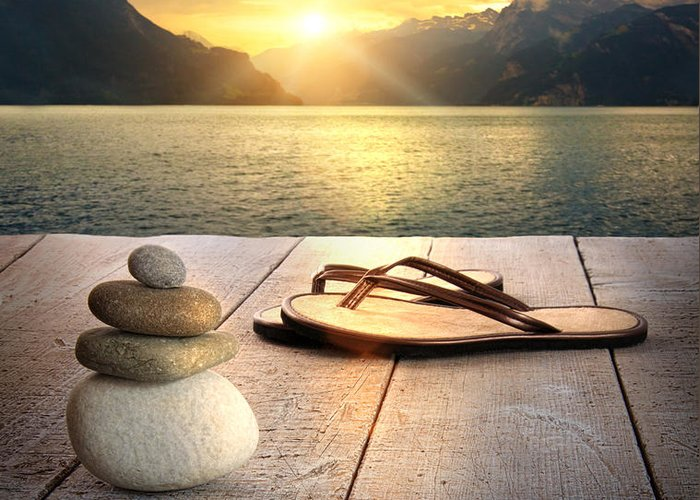 Arrangement Greeting Card featuring the photograph View Of Sandals And Rocks On Dock by Sandra Cunningham