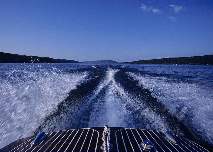 Finger Lakes Greeting Card featuring the photograph Waves Left In The Wake Of A Boat by Kenneth Garrett
