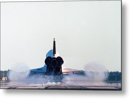 Horizontal Metal Print featuring the photograph Rear View Of The Landing Of The Space Shuttle by Stockbyte