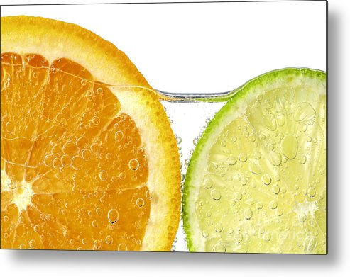 Orange Metal Print featuring the photograph Orange And Lime Slices In Water by Elena Elisseeva