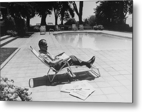 History Metal Print featuring the photograph Richard Nixon Reading Newspapers While by Everett