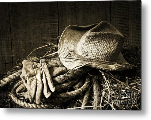 Bale Metal Print featuring the photograph Straw Hat With Gloves On A Bale Of Hay by Sandra Cunningham