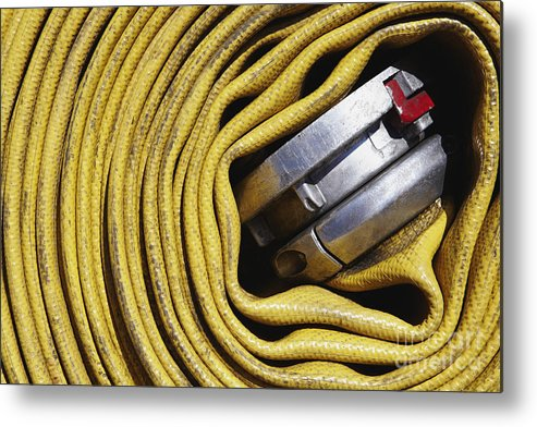 Close Up Metal Print featuring the photograph Coiled Fire Hose by Skip Nall