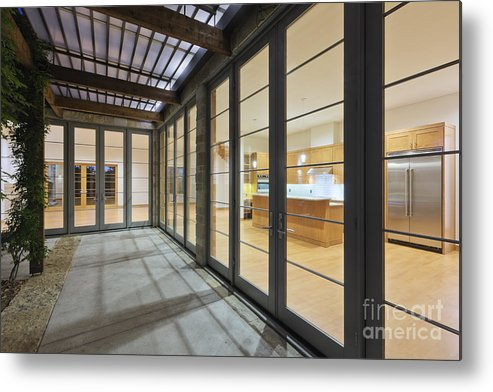 Architecture Metal Print featuring the photograph Modern Home Kitchen Through Glass Doors by Jeremy Woodhouse