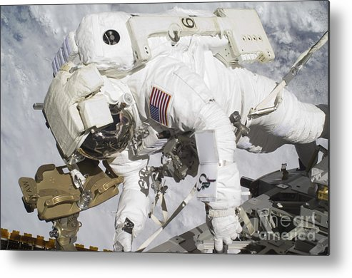 Components Metal Print featuring the photograph An Astronaut Participates In A Session by Stocktrek Images