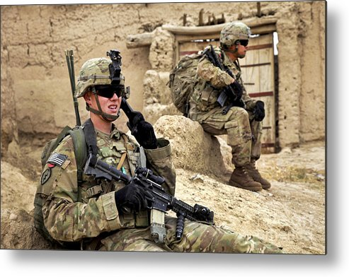 Afghanistan National Police Metal Print featuring the photograph A Soldier Calls In Description by Stocktrek Images