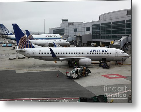 United Metal Print featuring the photograph United Airlines At Foggy Sfo International Airport . 5d16937 by Wingsdomain Art and Photography