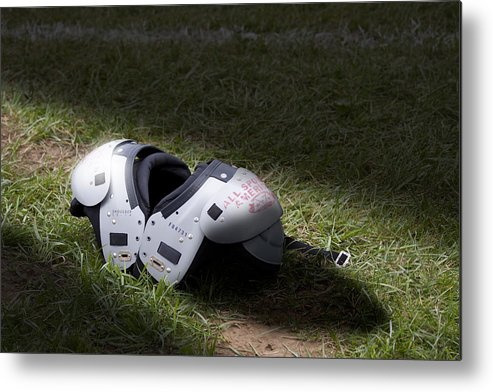 Football Metal Print featuring the photograph Football Shoulder Pads by Tom Mc Nemar