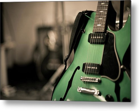 Horizontal Metal Print featuring the photograph Green Electric Guitar With Blurry Background by Sean Molin - www.seanmolin.com