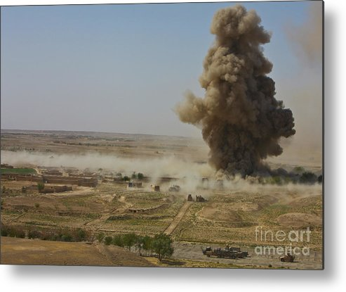 Improvised Explosive Device Metal Print featuring the photograph A Cloud Of Dust And Debris Rises by Stocktrek Images