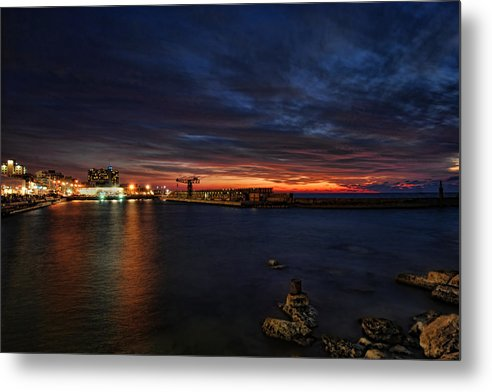 Israel Metal Print featuring the photograph a flaming sunset at Tel Aviv port by Ron Shoshani