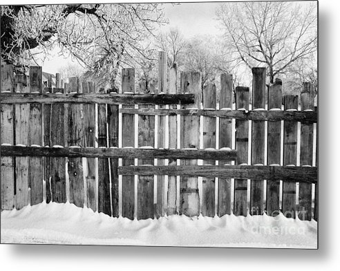 Old Metal Print featuring the photograph old patched up wooden fence using old bits of wood in snow Forget Saskatchewan Canada by Joe Fox