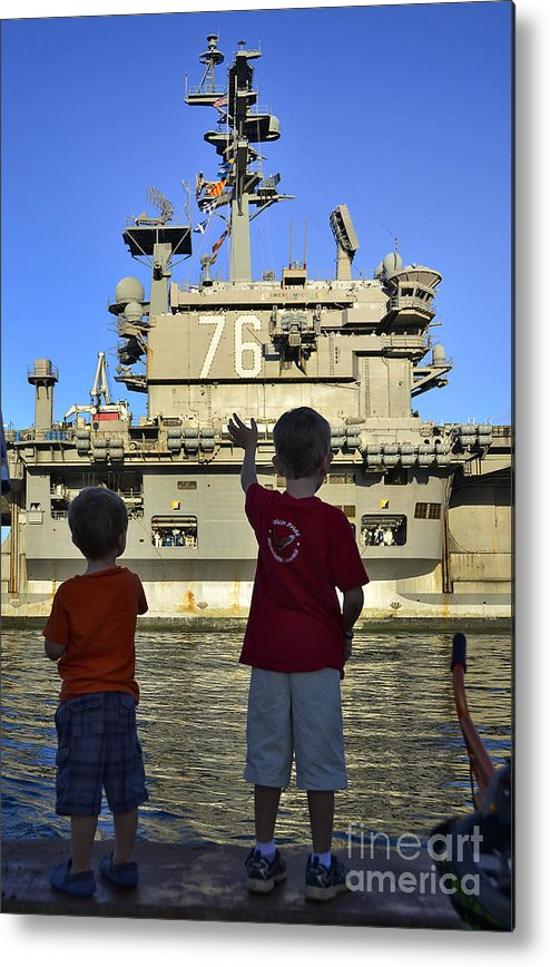 Aircraft Carrier Metal Print featuring the photograph Children Wave As Uss Ronald Reagan by Stocktrek Images
