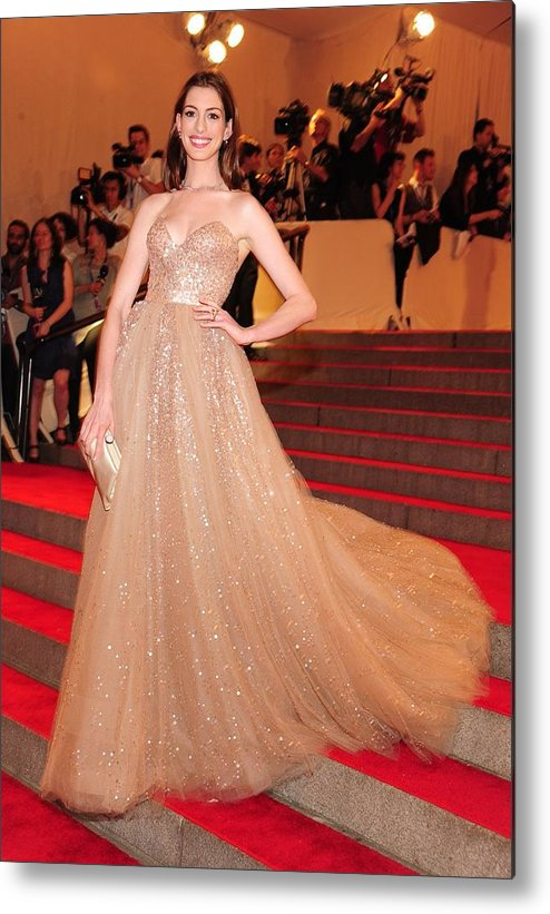 Anne Hathaway Metal Print featuring the photograph Anne Hathaway Wearing A Valentino Gown by Everett