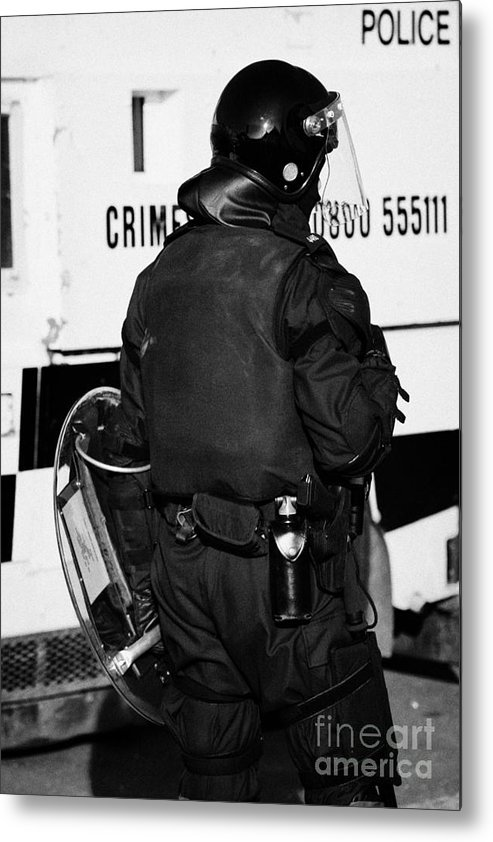 Northern Metal Print featuring the photograph Psni Officer With Riot Gear On Crumlin Road At Ardoyne Shops Belfast 12th July by Joe Fox