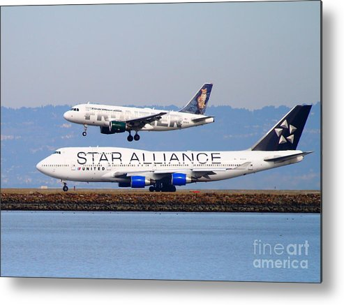 Airplane Metal Print featuring the photograph Star Alliance Airlines And Frontier Airlines Jet Airplanes At San Francisco International Airport by Wingsdomain Art and Photography