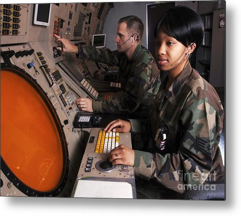 Horizontal Metal Print featuring the photograph Control Technicians Use Radarscopes by Stocktrek Images
