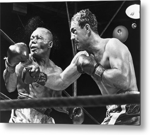 History Metal Print featuring the photograph Rocky Marciano Landing A Punch by Everett