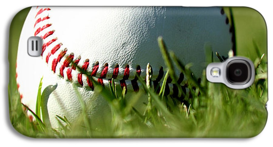 Baseball In Grass Galaxy S4 Case featuring the photograph Baseball In Grass by Chris Brannen