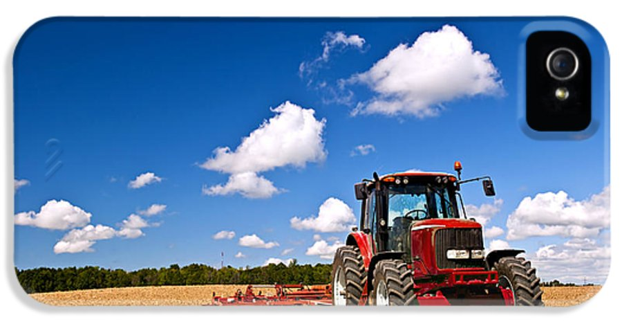 Tractor IPhone 5 / 5s Case featuring the photograph Tractor In Plowed Field by Elena Elisseeva