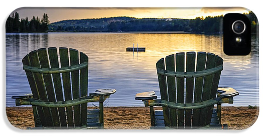 Lake IPhone 5 / 5s Case featuring the photograph Wooden Chairs At Sunset On Beach by Elena Elisseeva