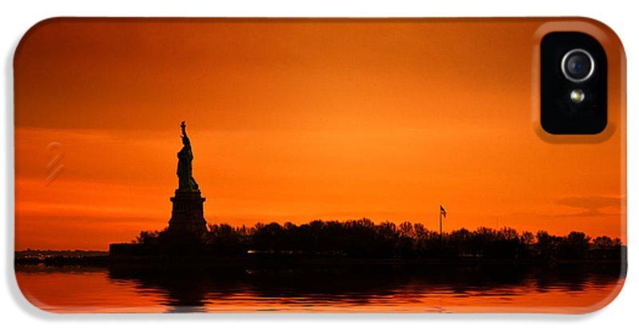 New York Skyline IPhone 5 / 5s Case featuring the photograph Statue Of Liberty At Sunset by John Farnan