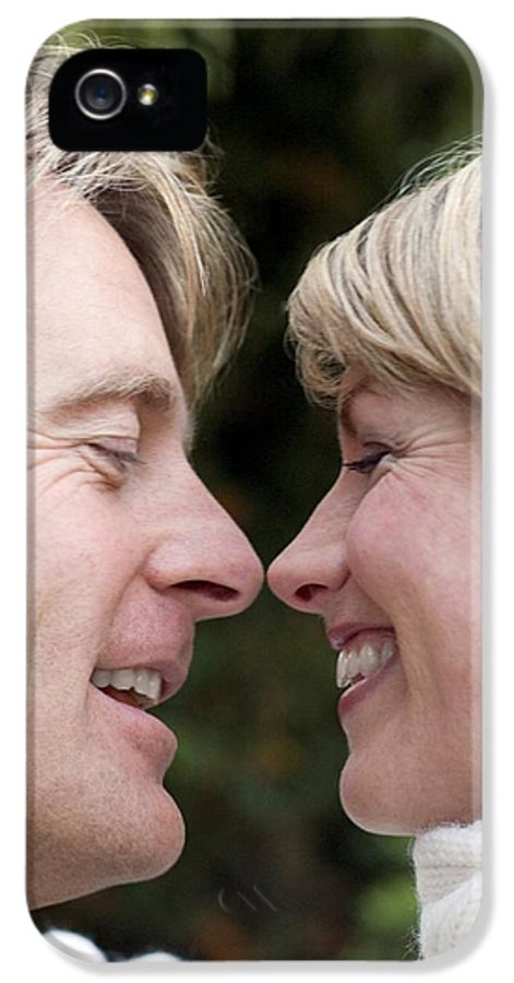 Human IPhone 5 / 5s Case featuring the photograph Smiling Couple Embracing by Ian Boddy