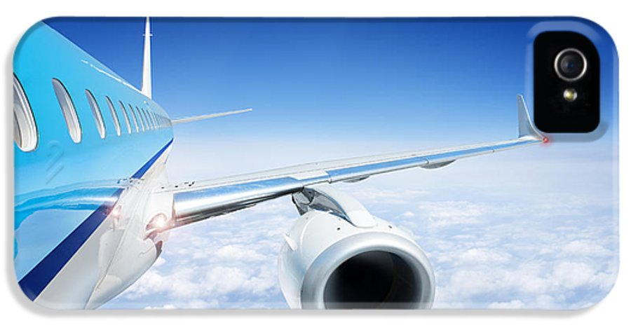 Flying IPhone 5 / 5s Case featuring the photograph Airliner In Flight Above The Clouds by Corepics