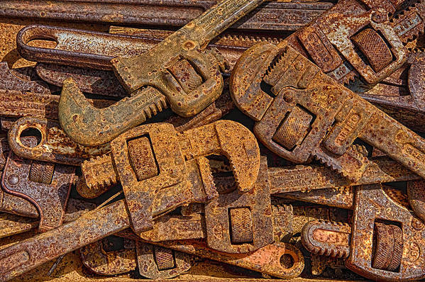 Rust Poster featuring the photograph Rusting Wrenches by Robert Jensen