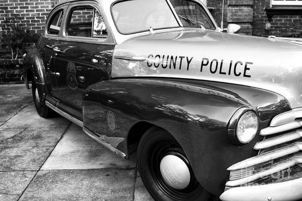 County Police In Black And White Poster featuring the photograph County Police In Black And White by John Rizzuto