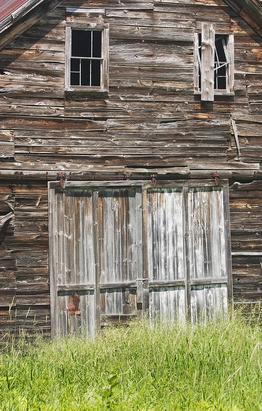 Barn; Building; Old; Old Barn; Maine; Abandoned; Maine Barns; Old Building; Obsolete; Beaten Up; Farm; Old Buildings Maine; Old Door; Weathered Door; Country Living; Farming; Building Exterior; Architecture; Shed; Wood Shingles; Structure; Window; Door; Weathered; Country; Rural; Rustic; Grass; Sunny; Wood; Siding; Spring; New England; Maine Buildings; Old Barns; Rustic Building; Abandoned Buildings Poster featuring the photograph Old Barn In Maine by Keith Webber Jr