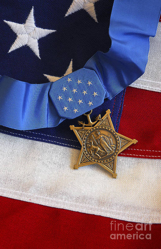 Medal Of Honor Poster featuring the photograph The Medal Of Honor Rests On A Flag by Stocktrek Images