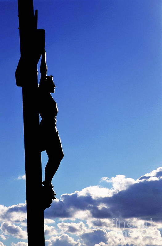 Christ Poster featuring the photograph Statue Of Jesus Christ On The Cross Against A Cloudy Sky by Sami Sarkis