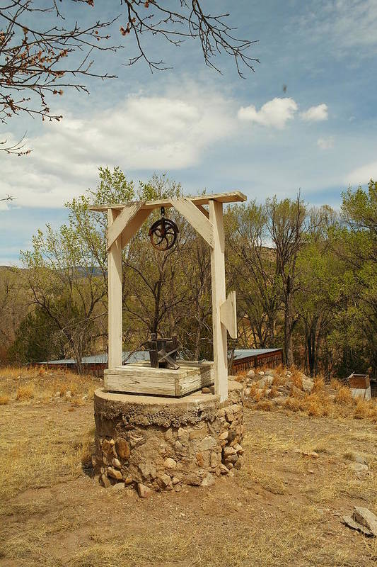 Water Poster featuring the photograph An Old Well In Lincoln City New Mexico by Jeff Swan