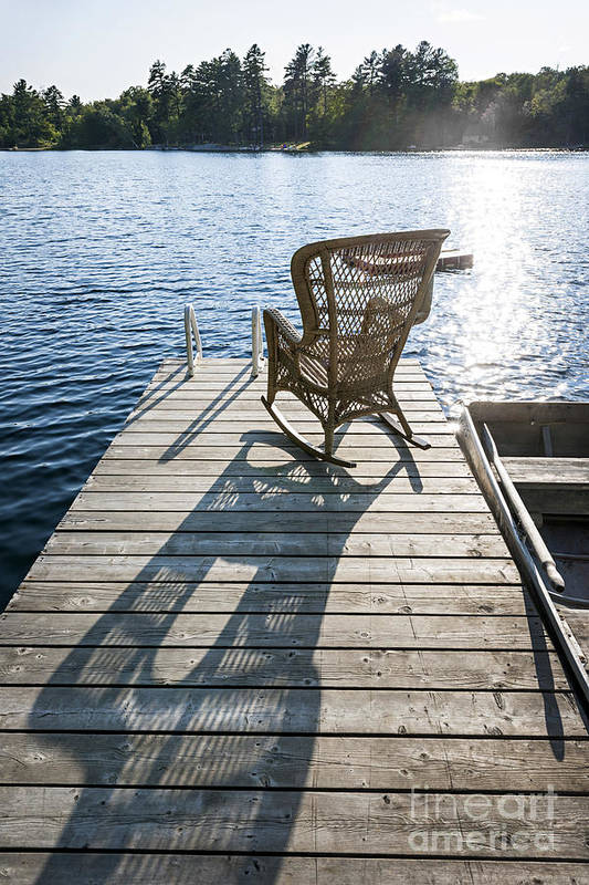 Rocking Poster featuring the photograph Rocking Chair On Dock by Elena Elisseeva
