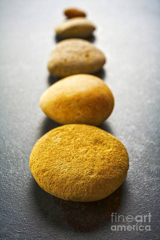 Stone Poster featuring the photograph Straight Line Of Brown Pebbles On Dark Background by Colin and Linda McKie