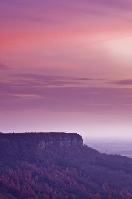Vertical Poster featuring the photograph A Colourful Sunset Over Sutton Bank by Julian Elliott Ethereal Light