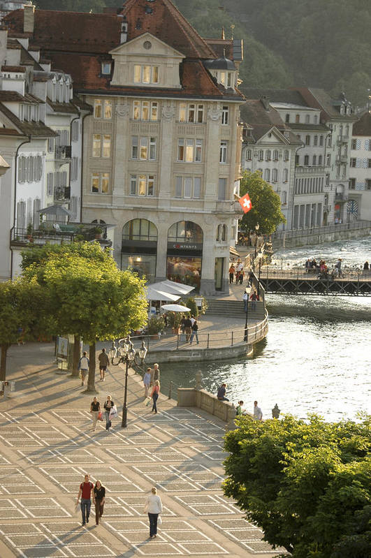 Outdoors Poster featuring the photograph A Lucerne Street Scene In The City by Annie Griffiths
